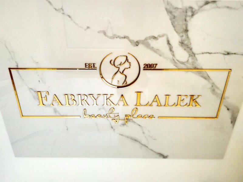 Złota reklama złote logo lustrzane