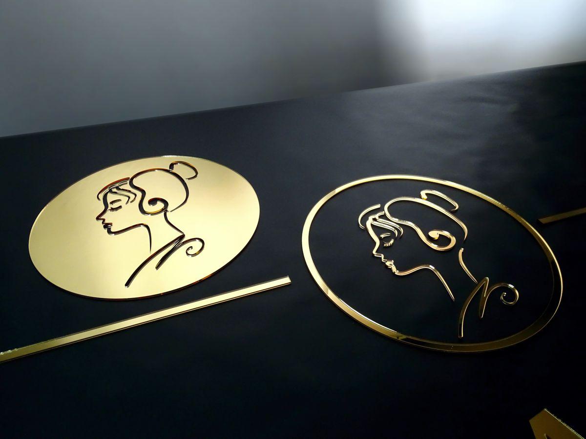 Logo wycinane z lustra złotego plexi reklama